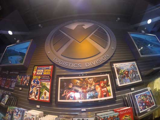 The back wall is where you will find the S.H.I.E.L.D. logo. Along with the large emblem you'll find some amazing collectibles that are worth more than just a quick look. #SuperheroHeadquarters #DisneySprings
