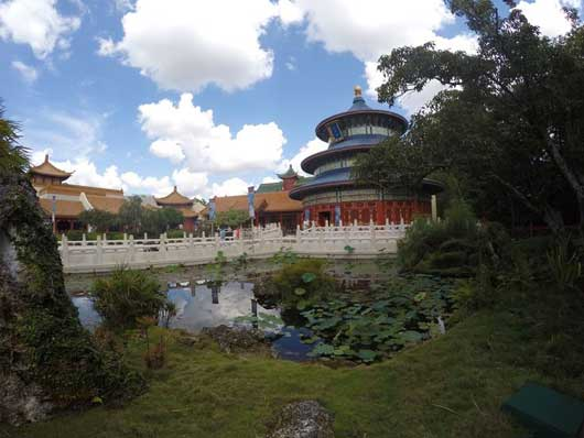 Epcot's China Pavilion is one that you should not just walk past. The picturesque ponds and structures quickly draw you in with their beauty. On the right you see the replica of the Hall of Prayer for Good Harvest, which you can visit without going to Beijing. #ChinaPavilion #Epcot Center