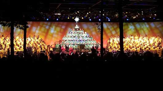 The Candlelight Processional is much more than a group of people singing on stage. One portion of the choir takes on the shape of a christmas tree while two other portions of the choir look like gifts. #EpcotCandlelightProcessional #Epcot
