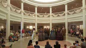 Inside the min building you will also find benches to relax on. Another treat is the singing that takes place in the center of the hall. After a few classic songs the performers take song requests as you wait for The American Adventure Attraction to begin. #AmericanPavillion #WorldShowcase